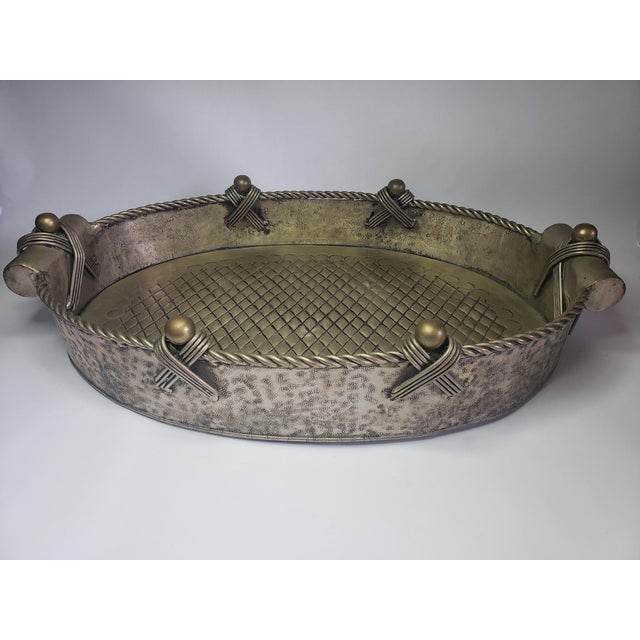 Vintage John Richard Collection Silver Plate Hammered Oval Serving Tray. Handcrafted oval tray with ornate detailing. The...
