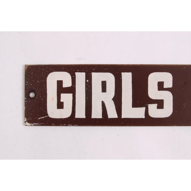 "Vintage brown and white hand lettered on masonite one-sided ""Girls Toilet"" sign, found in Cleveland. Sign has holes where..."