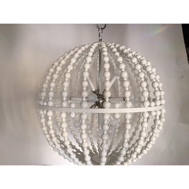 Original Design by Massimo Frank Lighting -29inch circular chandelier, with white wooden balls and a modern silver...