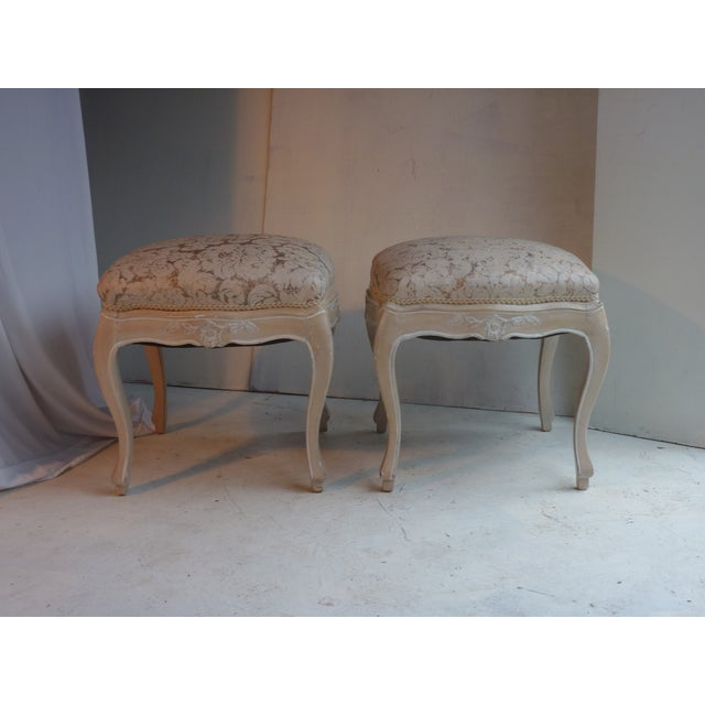 19th century pair Louis XV style painted stools with pegged construction. Fortuny style upholster. Sturdy. The upholstery...