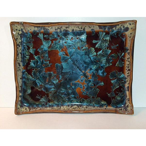 A unique handmade crystalline glazed pottery plate/tray in a dynamic, dramatic macro-crystalline glaze. Each piece created...