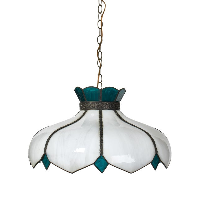 Simple yet grand fixture. Textured aquamarine glass contrasts nicely with the smoothness of the large white slag glass...