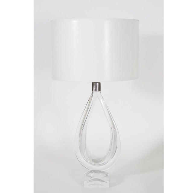 This crystal clear glass lamp from Daum is a great example of mid-century modern sculptural elegance. The piece begins in...