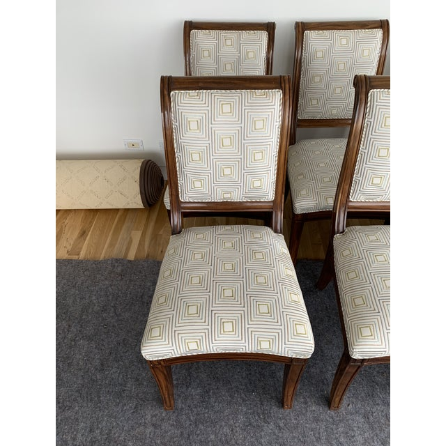 Set of 8 armless dining chairs. Upholstery has spots and areas of wear, would recommend reupholstery. Wood surrounds...