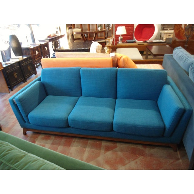 This is a brand new Ceni lagoon blue sofa from Article, perfect for any style of home. The legs are walnut.