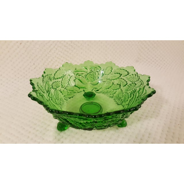 This is a beautiful antique bowl with an intricate rose motif. 3 footed base with beautiful detail. This would be a...