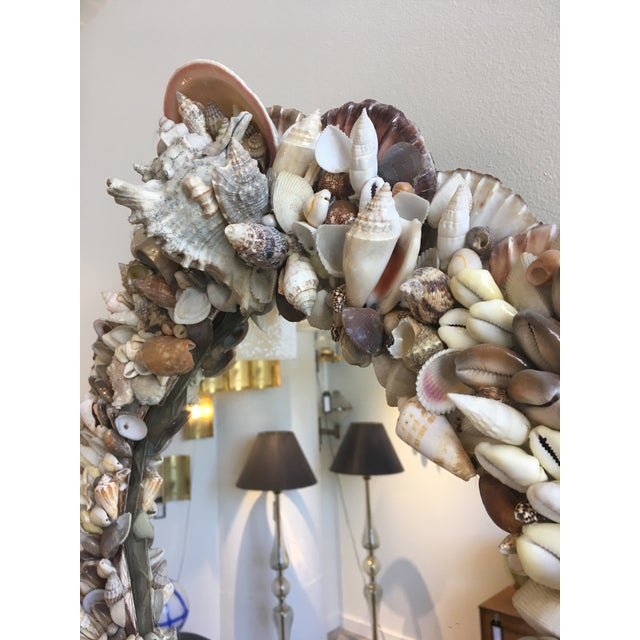 Vintage mirror adorned with shells. Highly detailed and in excellent condition. Every part of the frame has been...