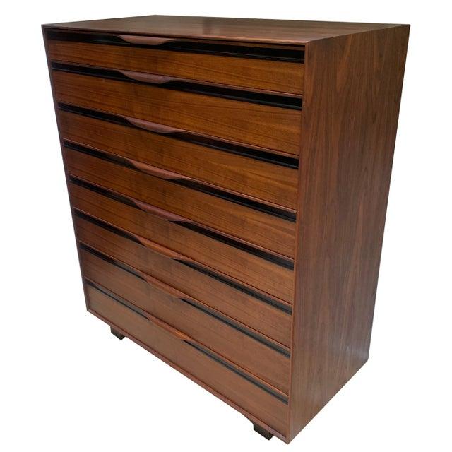1950s mid-century modern highboy eight-drawer walnut dresser by John Kapel for Glenn of California. The drawers all glide...