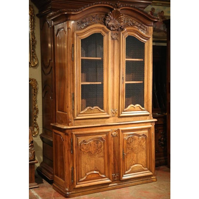 This exceptional, tall antique fruitwood buffet-deux-corps was carved in Lyon, France, circa 1750. Built in two parts,...
