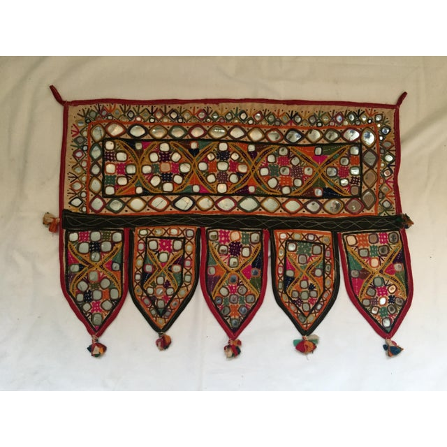 A vintage hand-embroidered mirrored cotton door or window valance with ribbon tassels. One of a kind. Purchased in Jaipur,...