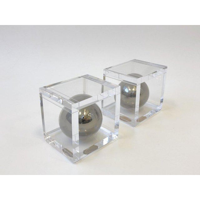 A glamorous pair of clear lucite and polish chrome bookends by renowned American designer Charles Hollis Jones. This are...