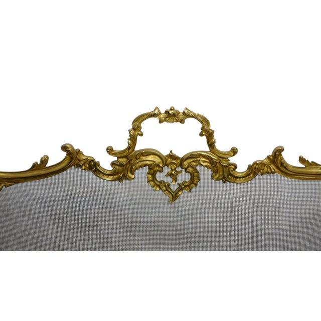Wonderfull Gilt Brass Fireplace Screen in the French Rococo manner with C scrolls, flowers and clam shell pad feet and...