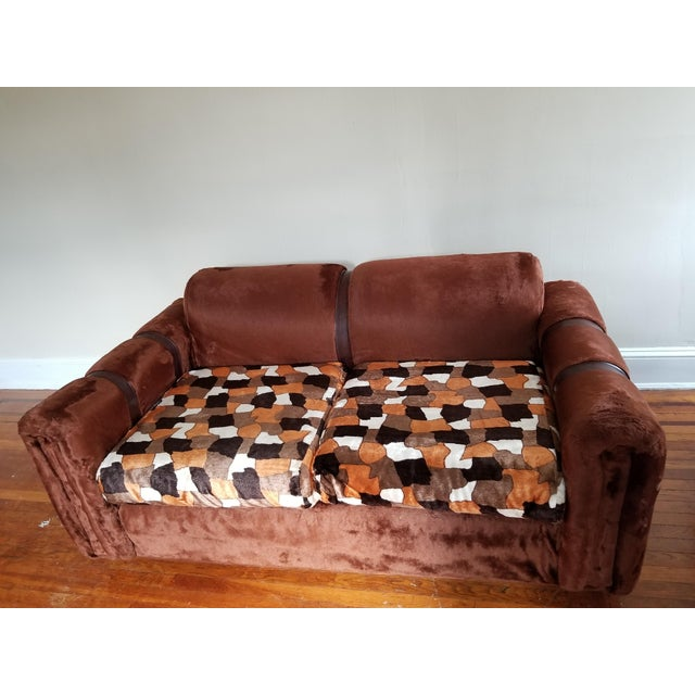 This loveseat/sofa are 2 pcs of a 3-piece set. A fur-like velvet material with leather straps. Gives the room a very retro...