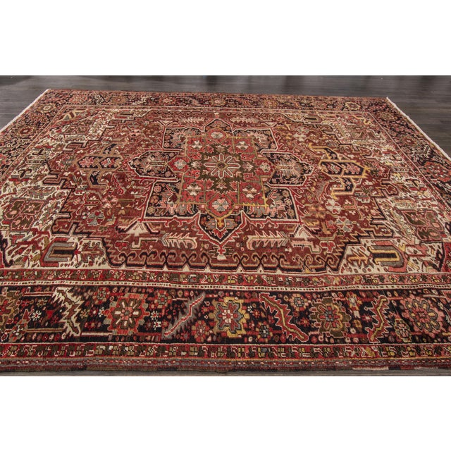 Vintage hand-knotted Persian Heriz rug with a medallion design. This piece has great colors and magnificent detailing, it...
