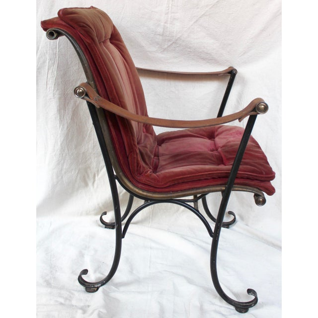 Mid 20th c. steel and brass campaign chair with velvet cover. Velvet is faded, stained, and worn.