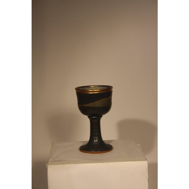 Large stoneware Chalice with blue/purple glaze and a gold luster rim. Signed with artists cipher. Possibly one of a kind,...