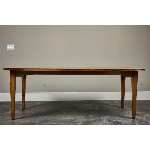 """A 20th century Indonesian teak dining table. Thick old growth 1.5"""" teak planks with rustic ridged detailing along edge...."""