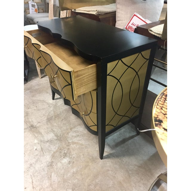 Chest made of yellow poplar and basswood veneer. Rustic black finish with antique-gold painted sides and front and matte-...