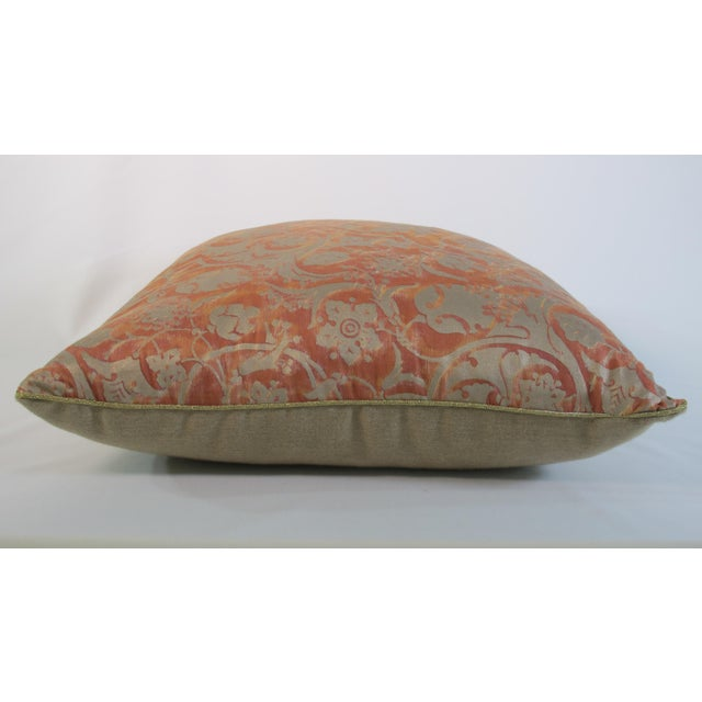 A pillow made from Fortuny's iconic hand printed fabric. A down insert is included