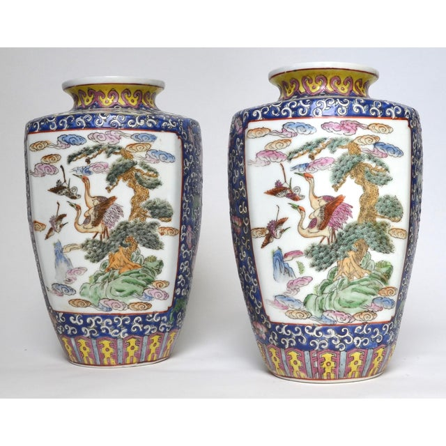 Lovely pair of Chinese Famille Rose porcelain vases in baluster form painted with red-crowned cranes and pine tree and...