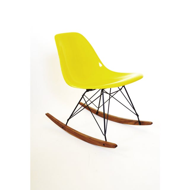 Original Eames, bright yellow Herman Miller rocking chair! Beautiful rich colored fiberglass shell on a brand new black...