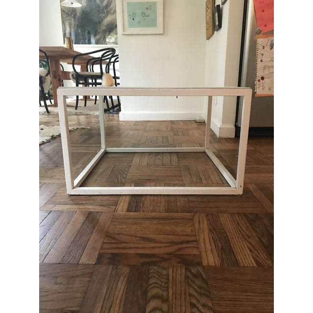 Pretty square contemporary coffee table form ABC carpet and home. White painted wood top and metal legs