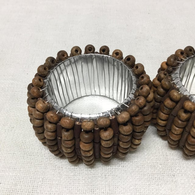 Shabby Chic Mid-Century Wood Beads With Silver Lining Napkin Rings - 4 Pc Set For Sale - Image 3 of 6