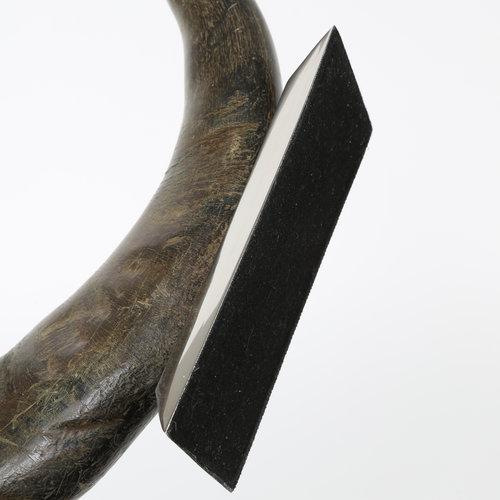 Decorative water buffalo horn mounted on a rectangular, tapered, slightly curved polished-stainless-steel base. We believe...