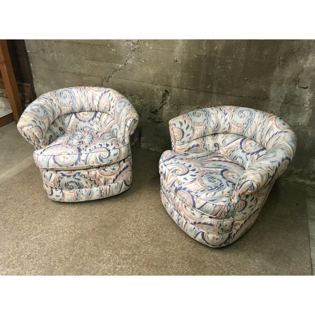 Gorgeous pair of petite swivel club chairs in a wonderful Ikat fabric. Completely new foam and self piping detail, these...