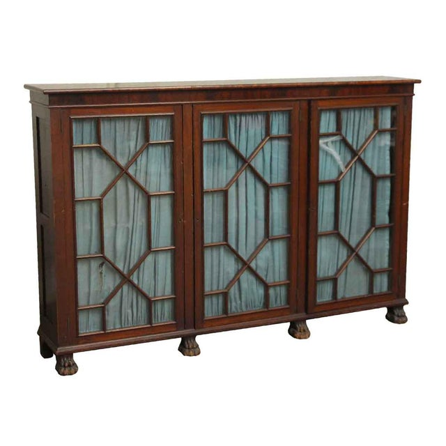 Mahogany carved base breakfront bookcase with mullion glass doors on ball & claw feet. Made in the late 20th century.