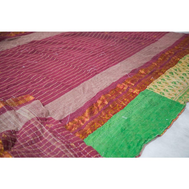 Vibrant one-of-a-kind twin size quilt / throw featuring the extraordinary Kantha hand-stitch connecting upcycled vintage...