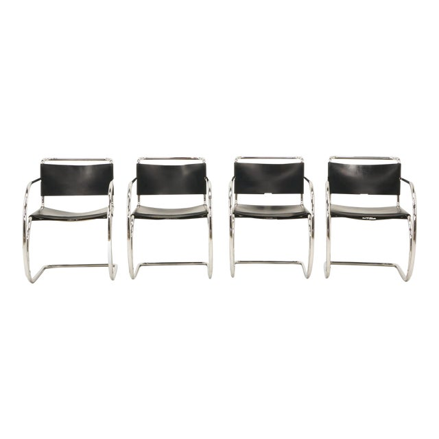 Four Ludwig Mies van der Rohe black leather and chrome tubular steel MR 20 armchairs. Manufactured by Knoll in Italy,...