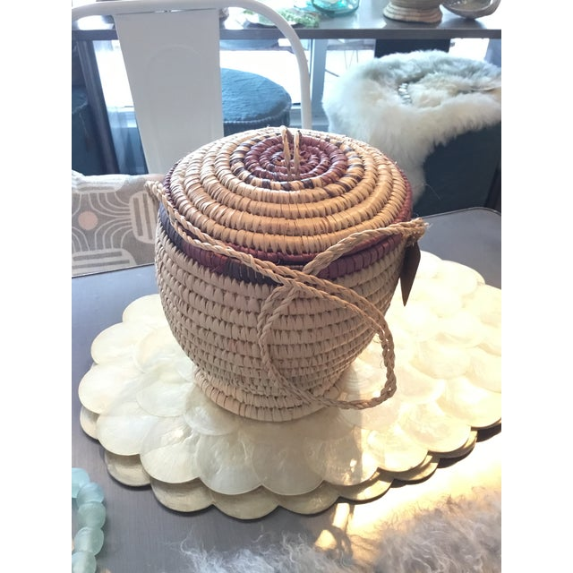 Adorable hand woven basket from Nigeria. Originally meant to carry food, this basket will add interest and texture to any...