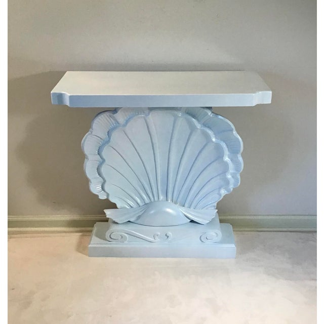 One-of-a-kind Hollywood Regency style console, totally hand carved scallop shell on base. Newly lacquered in a lovely...