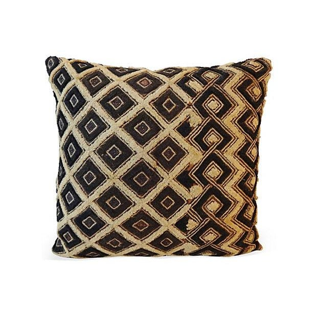 African Kuba pillow with delicate embroidered geometric design made of raffia from a palm tree. Dyed by women and woven by...