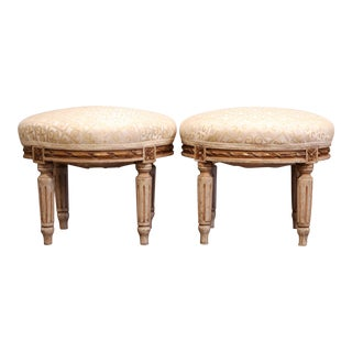 Pair of Early 20th Century French Louis XVI Carved Painted and Gilt Footstools For Sale