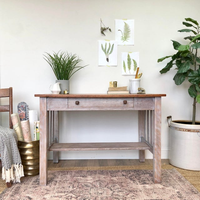 Let this small antique desk add lots of function to your home office or entryway — a solid oak writing desk from the early...
