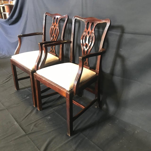 A set of six very handsome fine English Chippendale style dining chairs with two armchairs and four side chairs. Each...