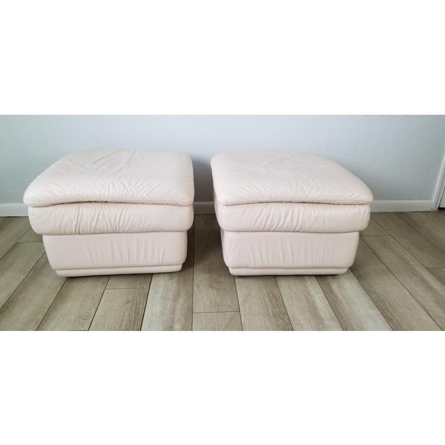 Nice pair of Vintage / Postmodern Style Italian Pink Leather Ottomans A Pair casters on the underneath that do not show....