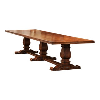 Large French Louis XIII Style Walnut Trestle Farm Table With Three Carved Legs For Sale