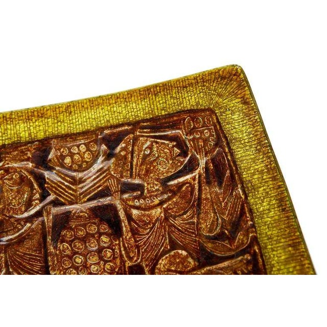 This beautiful platter / wall-plaque -- depicting two figures carrying foodstuffs to market, accompanied by a ravenous...