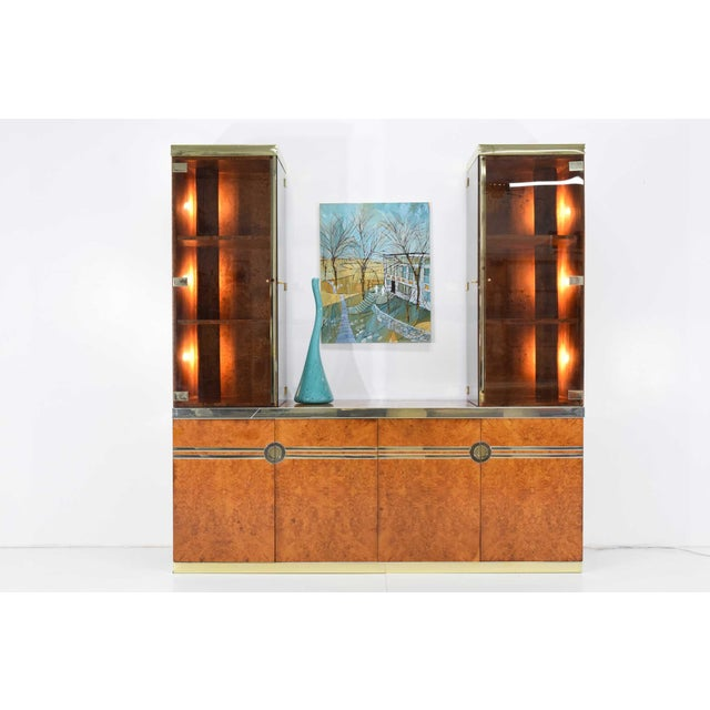 Beautiful burl wood sideboard with gold trim by Pierre Cardin. Cabinet has four doors that open for great storage and one...