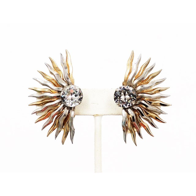 """1950s goldtone and silvertone clear rhinestone sunburst clip back earrings. Marked """"Napier."""" Measure: 1.94 inches L x 1.13..."""