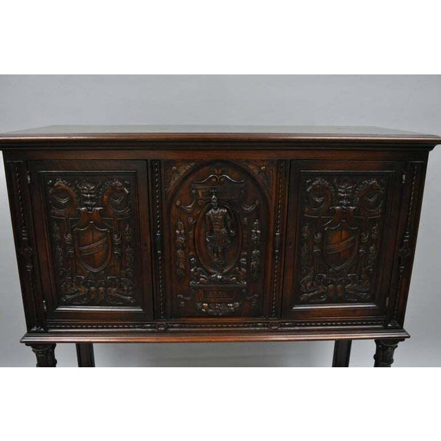 Antique Renaissance Revival Figural Carved Walnut Cabinet. Item Features Ornately Carved Walnut Panels Of Shields And...