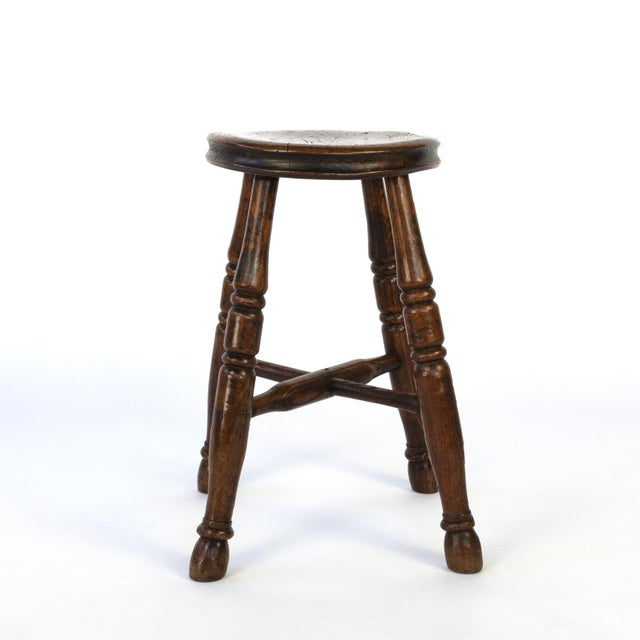Round Fruitwood work stool with four turned legs and turned crossed stretchers; circa 1870. height: 19 in. 48 cm.,...