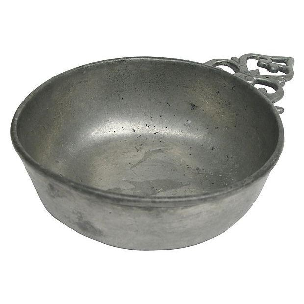 Antique French porringer in pewter with lovely cutwork handle. Perfect for displaying collections of small articles such...