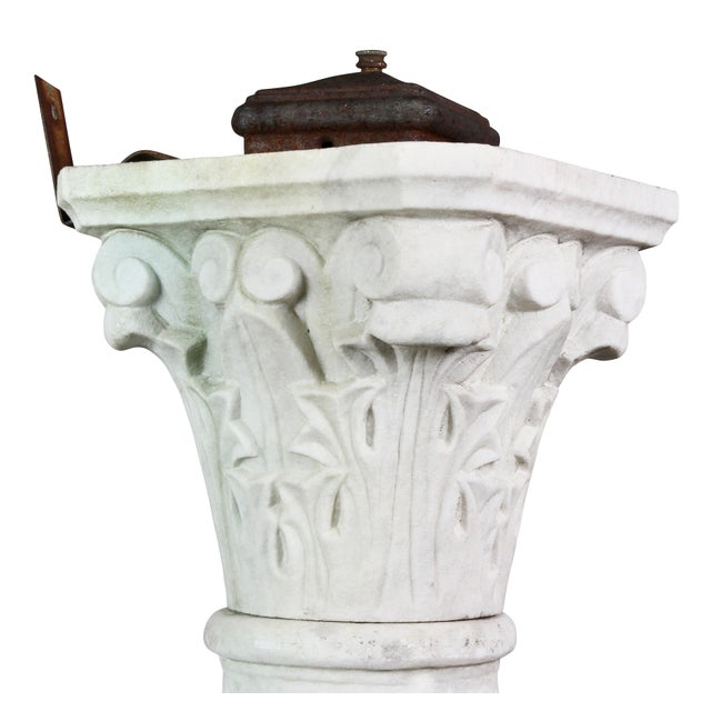 Originally used in a garden and was electrified. Stylized Corinthian capitol with the remains of an old metal switch box,...