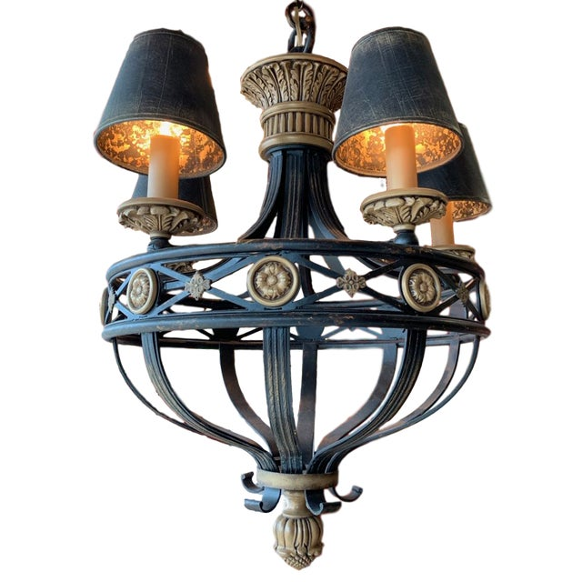 Fine Art Lamps black and gold chandelier. A sort of French Renaissance style that emulates wrought iron and bronze doré....