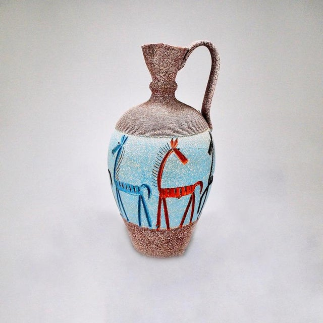 Circa 1970's jug form vessel attributed to Fratelli of Italy with a wide light blue salt-like glaze and incised, multi-...