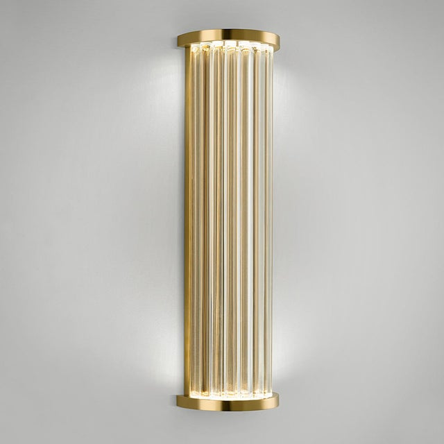 A polished brass dimmable wall light made with individual clear rods rods throught which the LED light source sparkles...